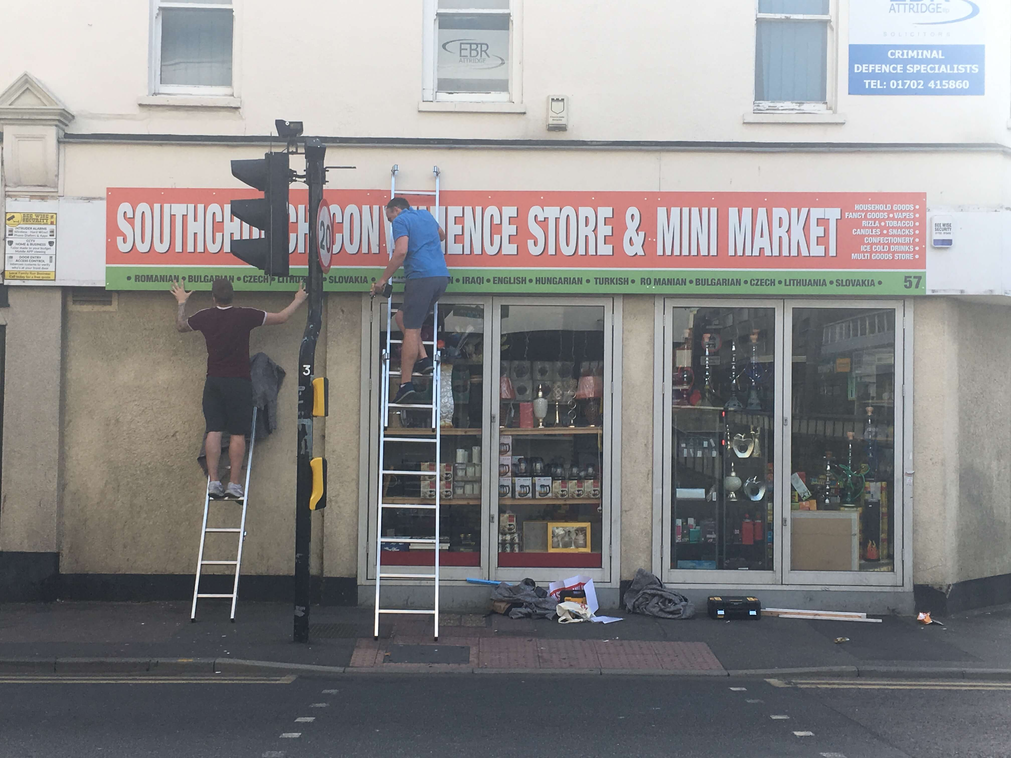 Shop sign being fitted