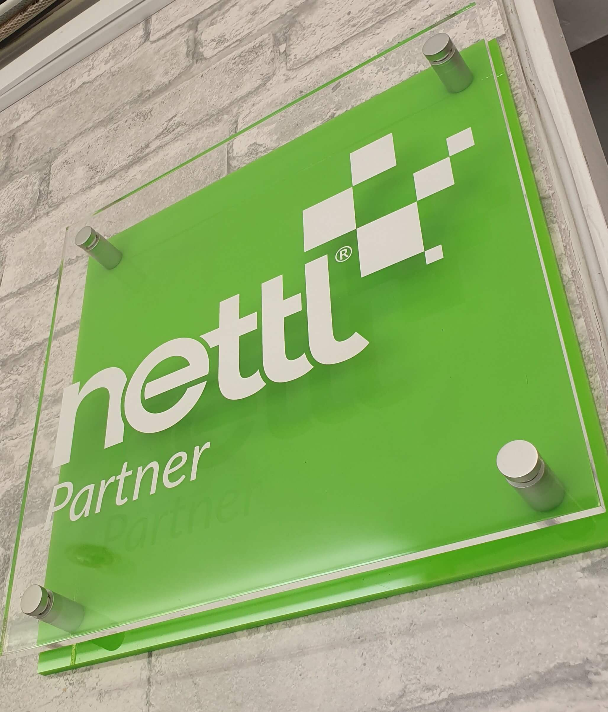 nettl perspex sign