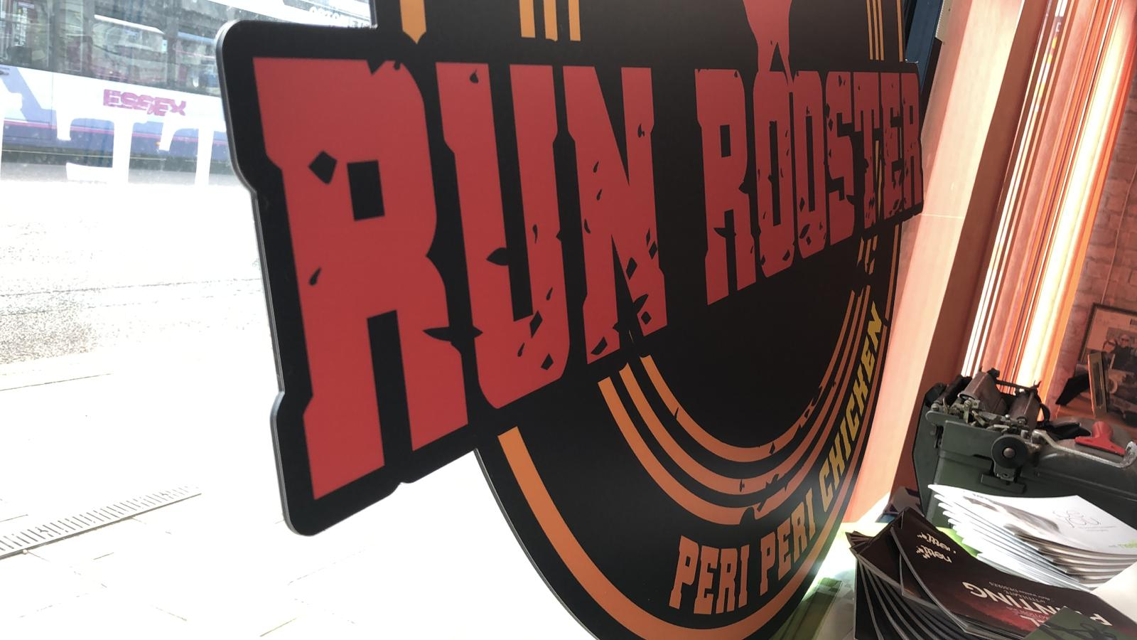 Run rooster shop sign